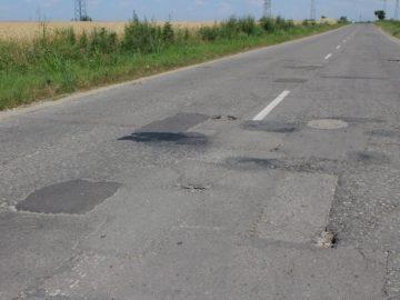 път с дупки шосе асфалт